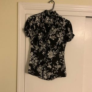 Adorable black with white flower shirt!